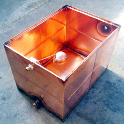 High temperature copper header tank showing metal valve and float